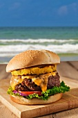 Cheeseburger with Tomatoes, Red Onion, Lettuce and Grilled Pineapple; By the Beach