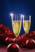 Two glasses of sparkling wine with Christmas decorations