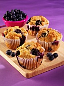 Blueberry muffins and fresh blueberries