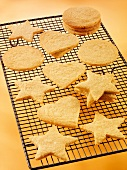 Biscuits in assorted shapes (hearts, stars, circles) on a cooling rack