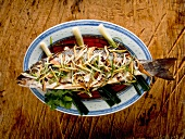 Fish with spring onions and matchstick vegetables (China)