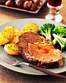 A Slice of Roast Beef with Broccoli and Roasted Chive Potatoes