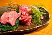 Raw Wagyu beef on a stone platter