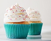 Cupcakes topped with icing and sugar pearls