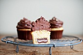 A cupcake cut in half to show the filling