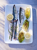 Mackerel in a mustard and onion marinade with fried lettuce hearts and lemon