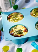 Mini courgette clafoutis in a muffin tin
