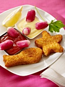 Breaded fish with red and white dips