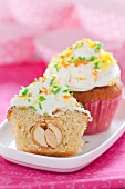 Cupcakes filled with coconut praline and topped with cream cheese and cream icing