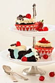 Cupcakes on a tiered cake stand: black forest and red velvet cupcakes