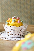 A cupcake topped with lemon icing
