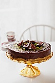 Truffle torte with figs on a torte stand