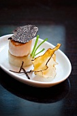 Scallops with truffles on a purée of Jerusalem artichokes