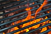A barbecue grill over the flame