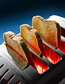Slices of toast in a toaster