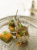 Baklava and mint tea on a silver tray