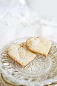 Two heart-shaped biscuits with vanilla sugar