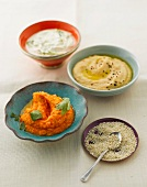 Assorted dips with sesame seeds