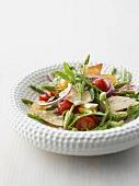 Wild asparagus salad with strudel chips, cherry tomatoes and onions