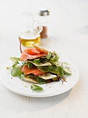 A salad of wild herbs with salmon and strudel chips