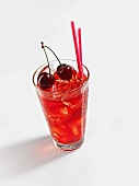 A glass of cherry tea with ice cubes