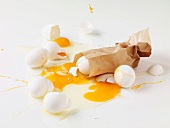 Broken eggs and a brown paper bag