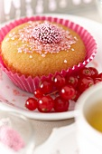 A cupcake with redcurrants