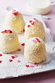White marshmallow kisses with grated coconut and sugar hearts