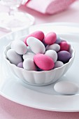 Colourful sugared almonds in a small bowl for a wedding