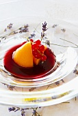 Melons with redcurrants in fruit sauce