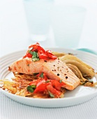 Poached salmon on potato rösti with tomatoes and fennel