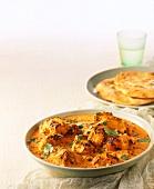 Chicken tikka masala with flatbread (India)