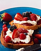 Brioche slices topped with cream cheese and berries