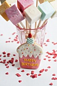 A birthday biscuit with marshmallows