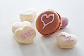 Macaroons decorated with hearts and writing using sugar icing