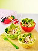 Three bowls of Caesar salad
