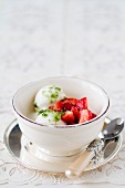 Frozen yoghurt with strawberry salad and basil sugar