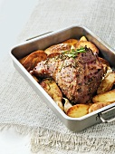 Leg of lamb with potatoes and herbs