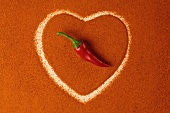 A heart of paprika topped with a chilli pepper