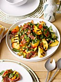 Grilled peach and pistachio salad with Prosciutto
