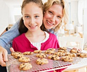 A mother and daughter with home-made biscuits