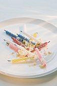 Birthday candles and crumbs on plate