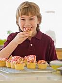 Boy eating home-made cupcake
