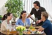 Couples dining on patio