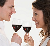 Profile of couple with red wine