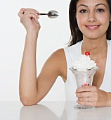 Smiling woman with ice cream sundae