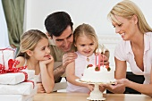 Girl celebrating birthday with family