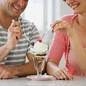 Couple sharing ice cream sundae
