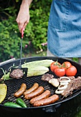 Grilling food outdoors in summer