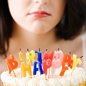 Woman frowning at blown out birthday candles